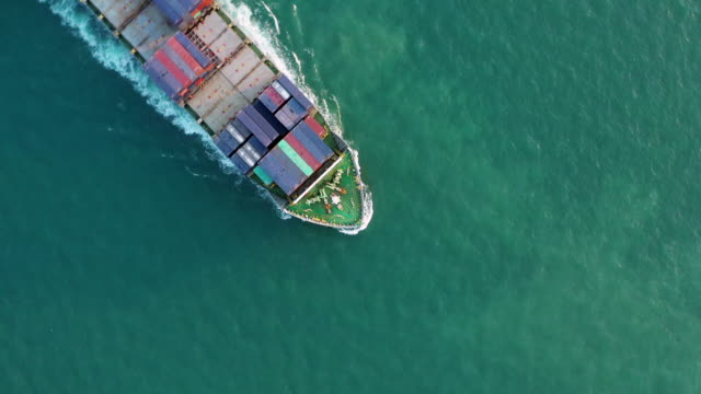 Container Ship Crossing over the sea