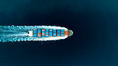 vídeos de stock e filmes b-roll de container ship crossing through the yavuz sultan selim bridge aerial drone footage - istanbul /4k - transporte assunto