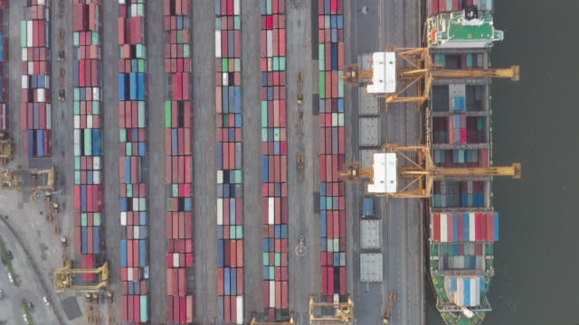 Container ship in import export and business logistic, By crane, Trade Port, Shipping cargo to harbor, Aerial view