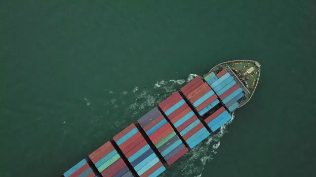 Container Ship in Sea Container Ship in Sea commercial dock stock videos & royalty-free footage