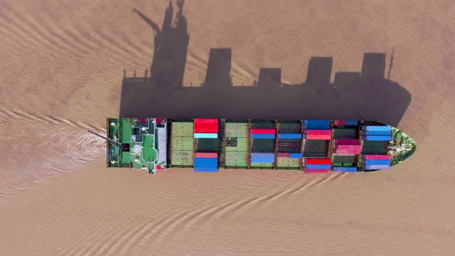 Container Ship with Long Shadow, Aerial Top View with Drone video