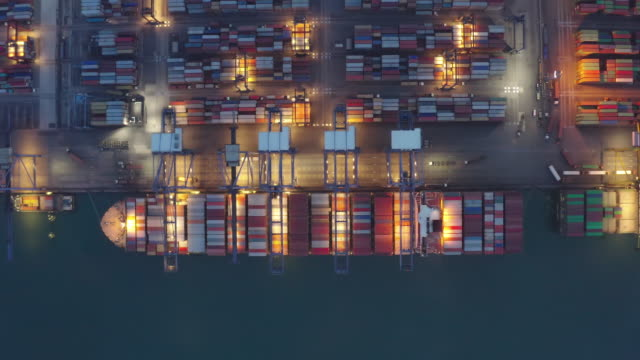 Container ship working at night, Business import export logistic and transportation of International by container ship in the open sea, Aerial view. Container ship working at night, Business import export logistic and transportation of International by container ship in the open sea, Aerial view. harbor stock videos & royalty-free footage