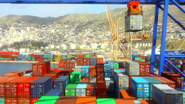 Athens, Greece - April 4, 2014: Containers being loaded onto a container ship at the port in Piraeus, a suburb of Athens, Greece.
