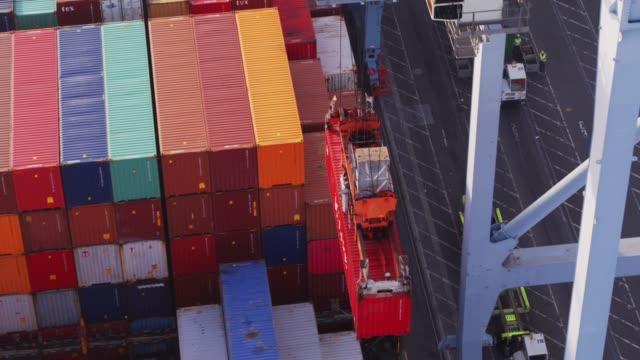 Containers Emerging From Deep Within Cargo Ship - Drone Shot video