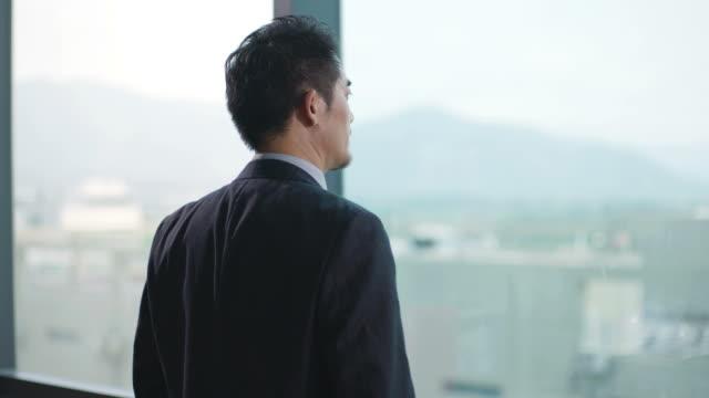 contemplative asian business man