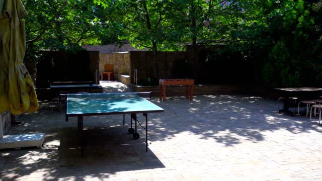 Contemporary shady backyard patio in sunny summer day