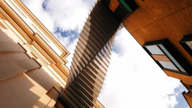 contemporary twisted architecture 4k - contemporary architecture stock videos & royalty-free footage