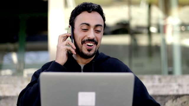 Content man using laptop and smartphone