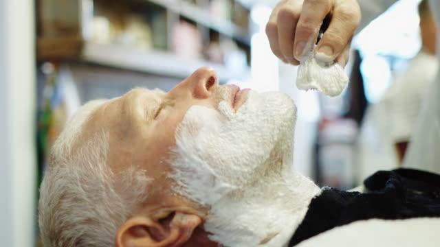 Contented Man Having Face Lathered in Barber Shop video