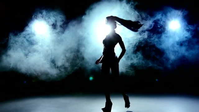 Continue dance of beautiful sexy girl in erotic black suit clothes, smoke, slow motion video