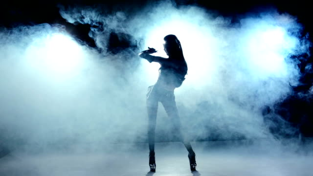 Continue dance of beautiful sexy girl in erotic black suit clothes, smoke video