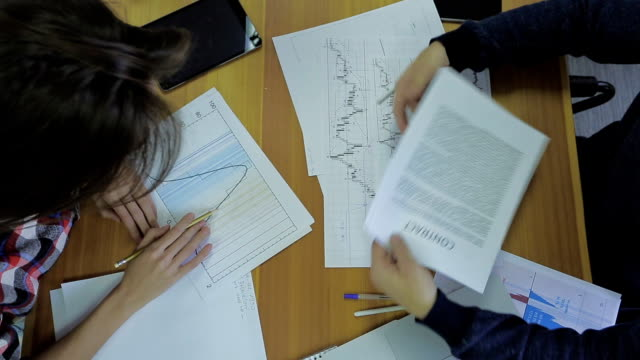 contract and financial indicators that are arranged on both sides. agreement businessman hands video