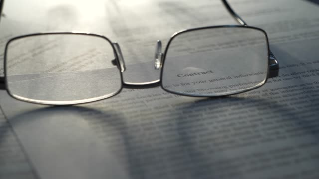 Contract terms and conditions legal law text through glasses video