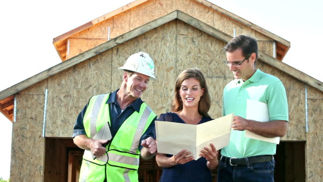 Contractor building home, with couple looking at plans video
