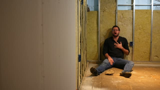 A contractor shocks himself from an electrical outlet in unfinished basement