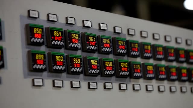 control panel in the factory, control buttons. modern plant, man buys buttons, close-up, interior, indoors video