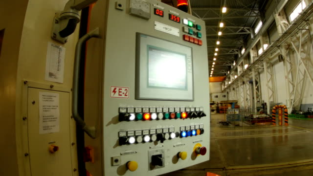 Control Panel with Colored Buttons in Factory Workshop
