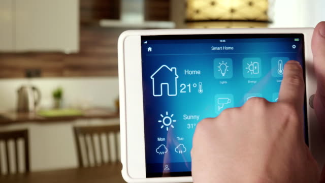 Controlling temperature in the house using app on the digital tablet video