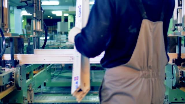 conveyor belt assembling plastic details. automated machine on a factory production line. - rivoluzione industriale video stock e b–roll