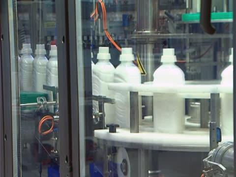 Conveyor Belt - Liquid Detergent Bottles Industrial production of liquid detergent.Plastic bottles moving on a conveyor belt. dishwashing liquid stock videos & royalty-free footage