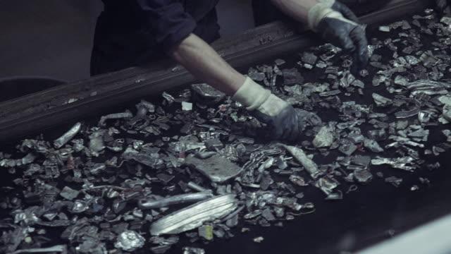 Conveyor belt transporting scrap metal video