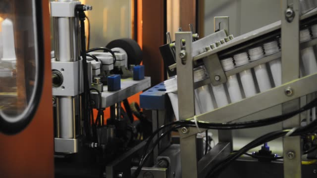 Conveyor of the production line with the production and blowing of plastic bottles at the factory Tripod shot of a production line conveyor molding a shape stock videos & royalty-free footage