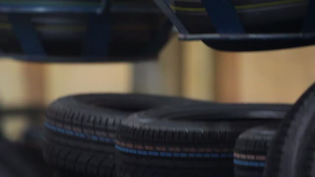 conveyor with tires at factory. tires production - modella negozio video stock e b–roll
