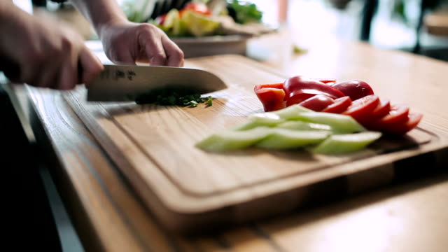 Cook chopped green onions on a cutting board video