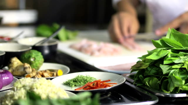 Cook chopping fish for sushi in restaurant kitchen video