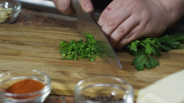 Cook Chopping Parsley video