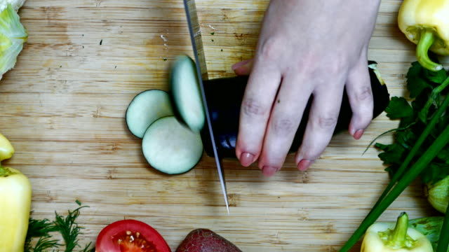 cook cuts eggplant rings, it is possible to insert text - melanzane video stock e b–roll