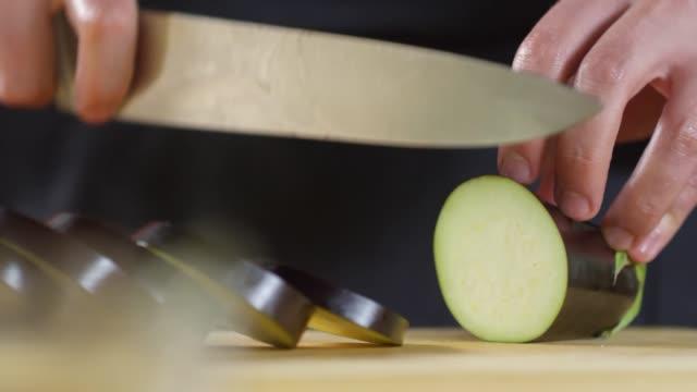 cook cutting eggplant - melanzane video stock e b–roll
