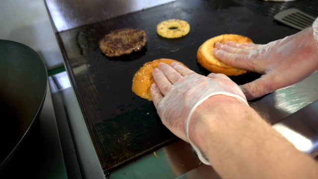 Cook fries buns and grilled meat for hamburger video