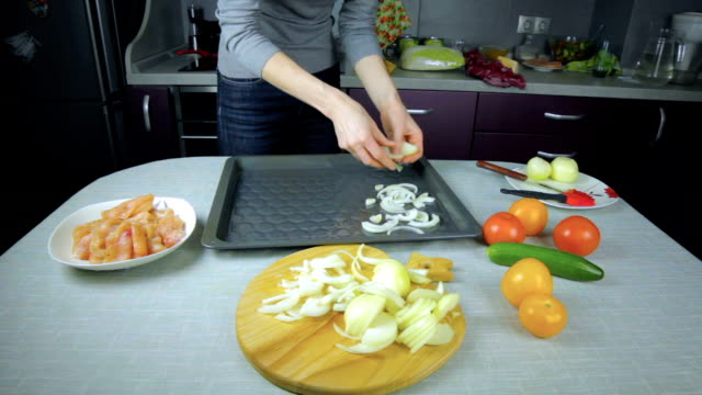 Cook onion lays on a baking sheet video