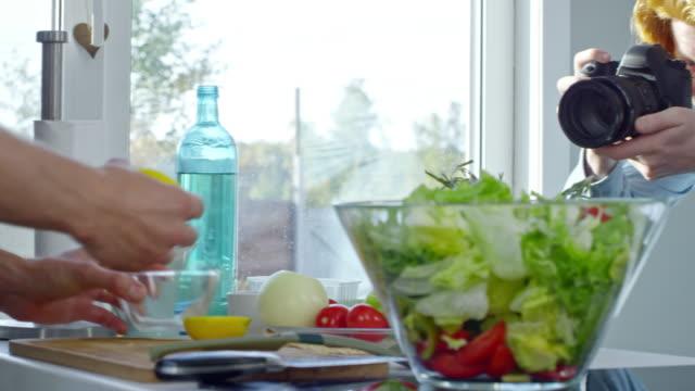 Cook Preparing Salad Dressing on Camera video