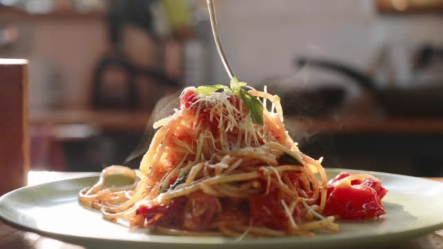 Cook serving spaghetti on the plate Cook serving spaghetti on the plate. Pours olive oil on ready to eat dish macaroni stock videos & royalty-free footage