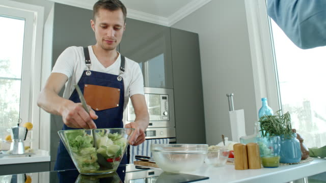 Cook Stirring Salad and Talking video
