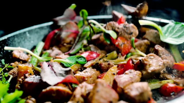 Cooked meat meal with vegetables black background cooking pan stock videos & royalty-free footage