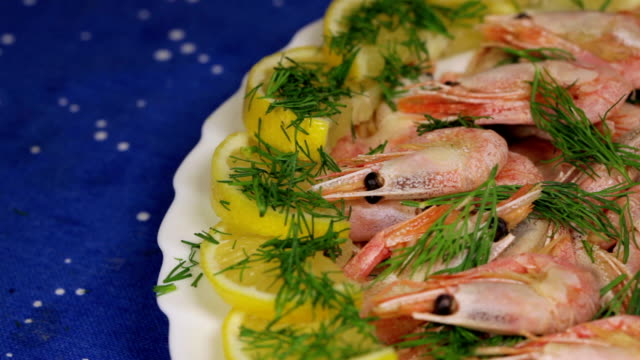 Cooked shrimps with lemon and dill on the plate video