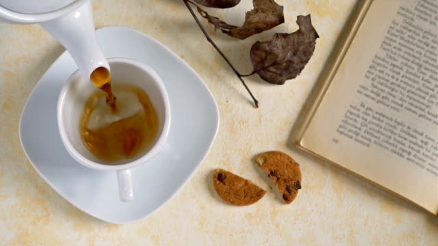 cookies and cup of tea on wooden background, slow motion. - disintossicazione video stock e b–roll
