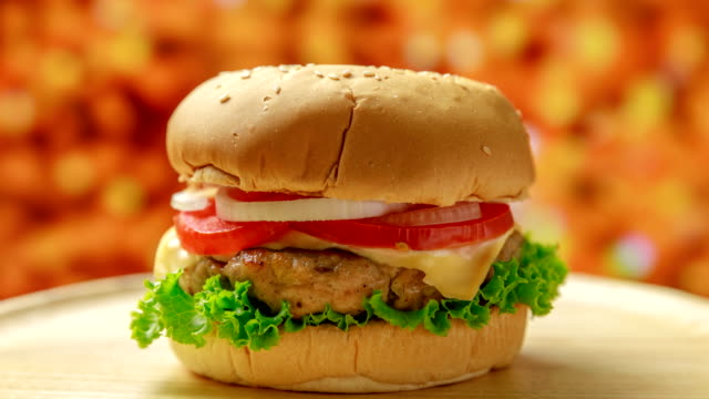 cooking a burger, layer by layer - burgers stock videos and b-roll footage