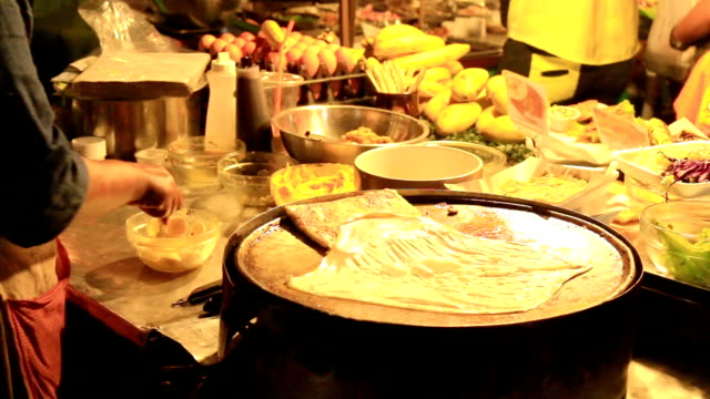 HD: Cooking at a street hawker mobile restaurant in Thailand video