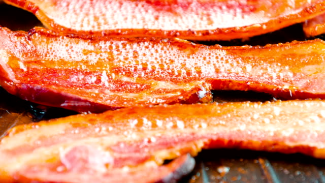 Cooking Bacon in oven Bacon being cooked in the oven bacon stock videos & royalty-free footage