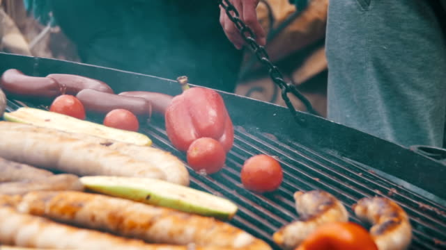 Cooking Barbecue Delicious Sausages and Vegetables on the Grill. Slow Motion video