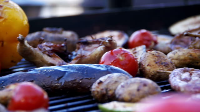 Cooking Barbecue Delicious Sausages, Meat and Vegetables on the Grill. Slow Motion video