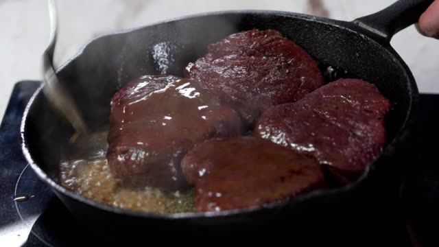Cooking beef meat in the pan video