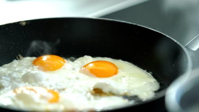 Cooking breakfast.
