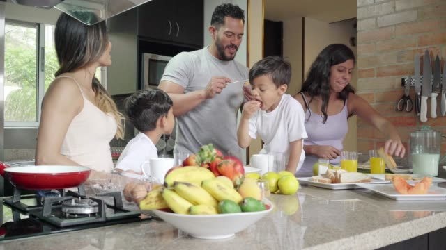 cooking breakfast with the family - family home video stock e b–roll