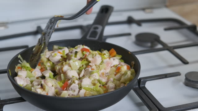 cooking chicken breast with vegetables. - articoli casalinghi video stock e b–roll