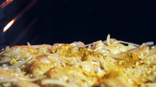cooking chicken in the oven cooking chicken in the oven baked at home roast dinner stock videos & royalty-free footage